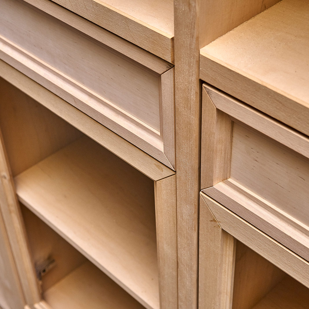 Beautiful professionally made wood cabinet in process of production in workshop. Bathroom vanity cabinet. Furniture manufacture. Close-up